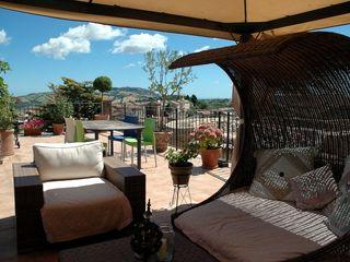 Ing. Vitale Grisostomi Travaglini Rustic style balcony, veranda & terrace