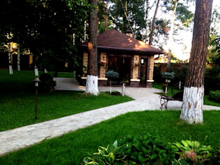 Dara Design Country style house Bricks Brown