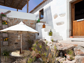 pedro quintela studio Rustic style house Stone White