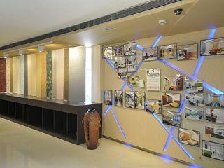 Alaya D'decor Espacios comerciales de estilo moderno Contrachapado Amarillo