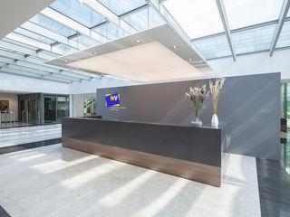 destilat Design Studio GmbH Modern office buildings Grey