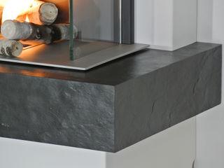 muenkel design - Elektrokamine aus Großentaft SalonesChimeneas y accesorios Negro