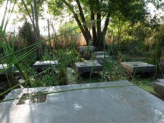 Recuperação de tanque junto a ribeira Atelier Jardins do Sul Jardins minimalistas