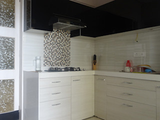 Charniwalas @ Tropical Lagoon. UNIQUE DESIGNERS & ARCHITECTS Modern kitchen