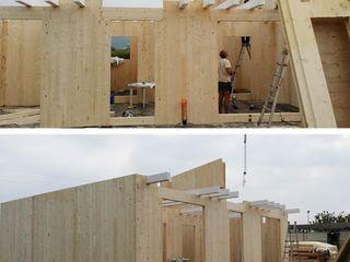 Casa in legno con struttura X Lam, provincia di Verona WoodLab Case moderne Legno