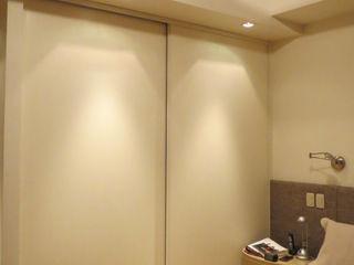 Estudio de iluminación Giuliana Nieva Modern style bedroom