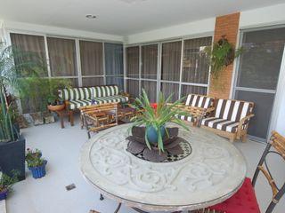 Emmilia Cardoso Designers Associados Modern balcony, veranda & terrace