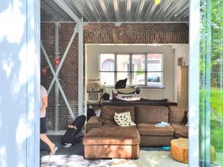 Tâcheron architect Ruang Keluarga Gaya Industrial