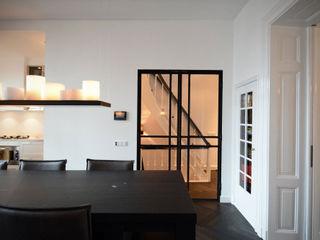 Ecker Keukens en Interieur Salones de estilo ecléctico