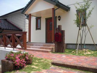 株式会社 砂土居造園/SUNADOI LANDSCAPE Country style garden