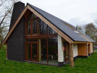 STROOM architecten Country style houses Stone Black