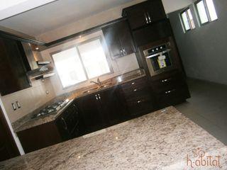 H-abitat Diseño & Interiores Cozinhas modernas Madeira Acabamento em madeira