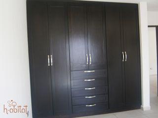 H-abitat Diseño & Interiores Closets modernos Madeira Acabamento em madeira