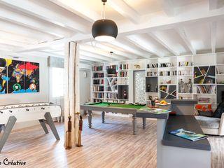 Réaménagement d'une salle de loisirs Agence boÔbo Salon moderne