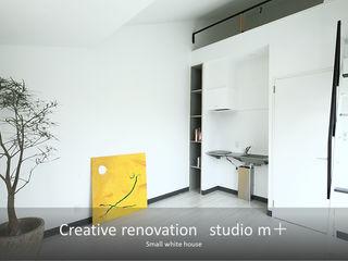 studio m+ by masato fujii Sala da pranzo moderna Bianco