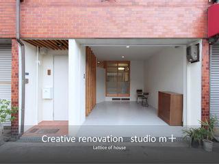 studio m+ by masato fujii Case eclettiche Legno