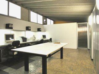 CoRREA Arquitectos Negozi & Locali commerciali moderni