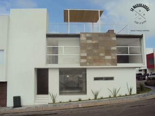 La Maquiladora / taller de ideas Casas de estilo minimalista