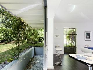Extension salle de billard O2 Concept Architecture Jardin d'hiver moderne Verre Blanc