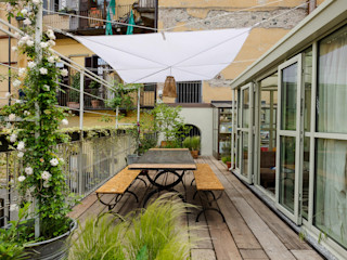 marta carraro Balcones y terrazas rústicos