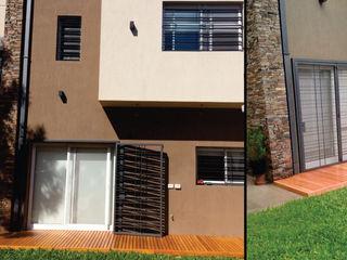 MONARQ ESTUDIO Modern houses Stone Brown