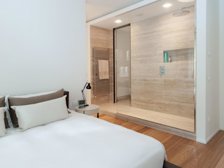 Studio Associato Casiraghi Minimalist bedroom Beige