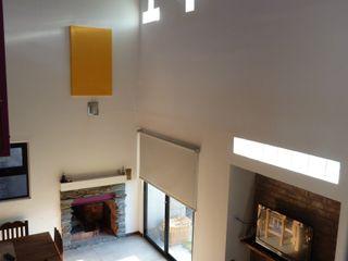 Casa CS 727 Patricio Galland Arquitectura Salas de estilo ecléctico