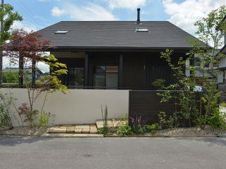 T's Garden Square Co.,Ltd. Casas estilo moderno: ideas, arquitectura e imágenes Madera Verde