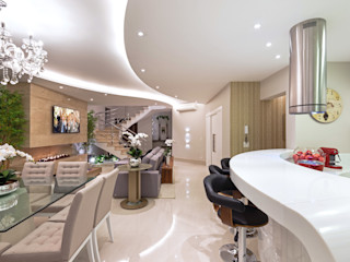 Designer de Interiores e Paisagista Iara Kílaris Salas de estilo moderno Beige