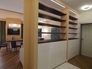 Bellarte interior studio Koridor & Tangga Minimalis Brown