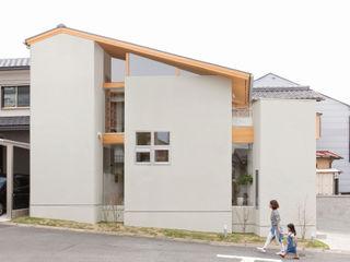 ALTS DESIGN OFFICE Дома в скандинавском стиле Камень Серый