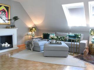 Wohnung im tropischen Stil Homemate GmbH Moderne Wohnzimmer Grau