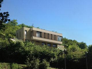 Maison d'Architecte IND Architecture Maison individuelle Bois massif Effet bois