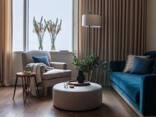 Дизайн бюро Татьяны Алениной Salas de estilo moderno Beige