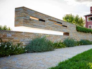 Garden Le Monde Alessandro Isola Ltd Pareti & Pavimenti in stile moderno Pietra