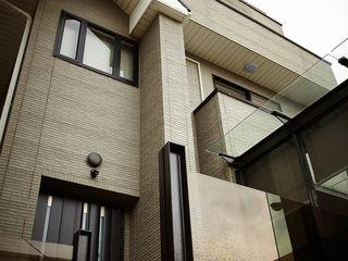 戎馬整合設計 Casas de estilo asiático