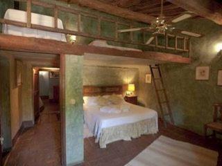 camera da letto b&b Studio Tecnico Progettisti Associati Ing. Marani Marco & Arch. Dei Claudia Camera da letto rurale