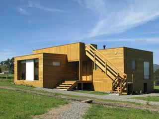 Taller de Ensamble SAS Modern houses Wood Wood effect