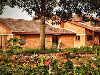 Nuvo Designs Rustic style house Bricks