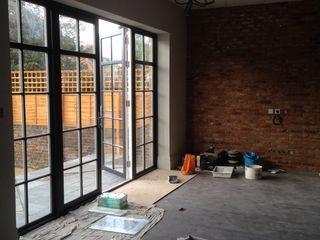 Rock star family home My-Studio Ltd Industriale Wohnzimmer Ziegel Schwarz