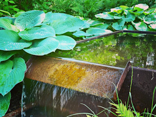 grasgrau - GARTENDESIGN Industrial style garden Iron/Steel