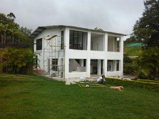 EcoDESING S.A.S DISEÑO DE ESPACIOS CON INGENIO Wiejskie domy
