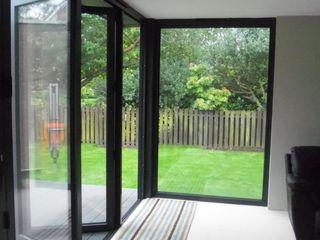Dab Den Extension Dab Den Ltd Modern Living Room Tiles