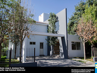 CASA ESPACIO DIONISIACO Excelencia en Diseño Casas modernas Ladrillos Blanco