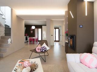 Rachele Biancalani Studio Salones de estilo moderno Hormigón Rosa