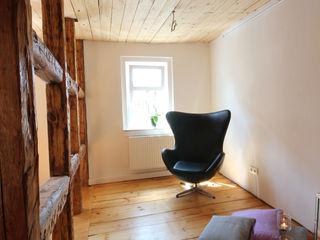 Saniertes Wohn- und Geschäftshaus Rudolstadt Planungsgruppe Korb GmbH Architekten & Ingenieure Moderne Wohnzimmer