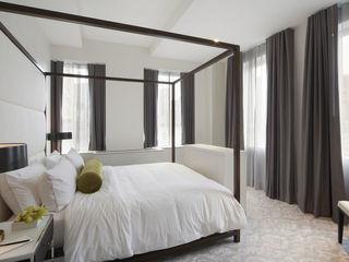 Joe Ginsberg Design Modern style bedroom Grey