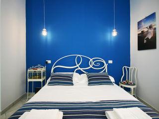 Casa Vacanze il Sebeto archielle Camera da letto eclettica Blu