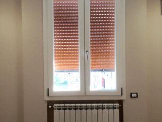 Casa S. Tinnirello Design Porte e Infissi Finestre & Porte in stile moderno PVC Effetto legno