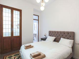 Rimolo & Grosso, arquitectos Dormitorios modernos Madera Multicolor